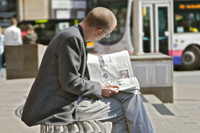 Man reading a newspaper on IFSD's Argyle Street